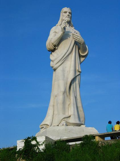 This statue seems to be blessing the city and its visitors